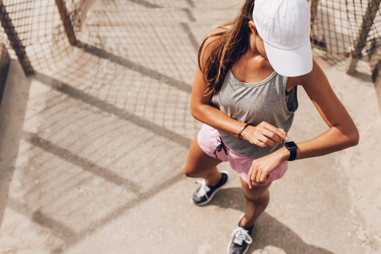 Girl tracking Fitness training on Smart Watch