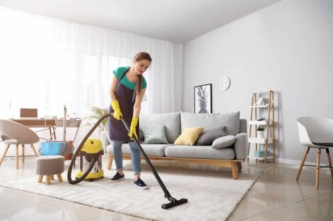 women cleaning home with vacuum cleaner