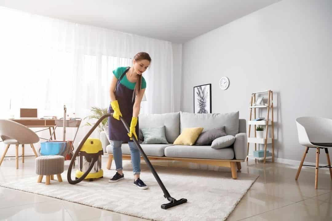 she cleaning home with vacuum cleaner