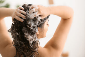 Wash your hair with a smoothing shampoo